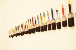 Paint brushes on wall  Photo by Degilbo on flikr