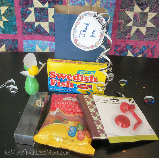 Teacher gift with fan, Swedish Fish, bookmark, gummy bears, notebook, tiny desk lamp