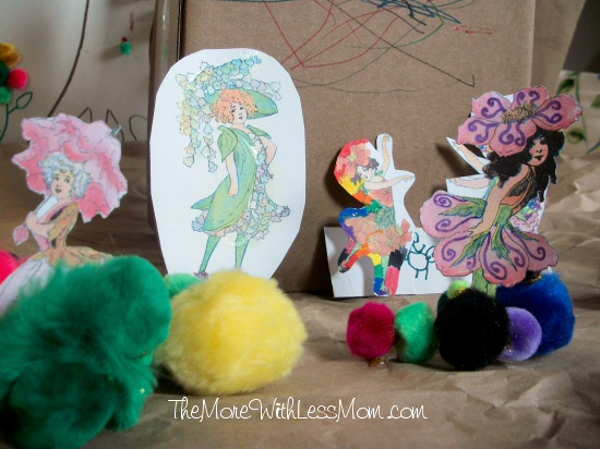 Flower fairies frolic on a cardboard box house