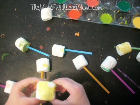 Preschooler painting marshmallows
