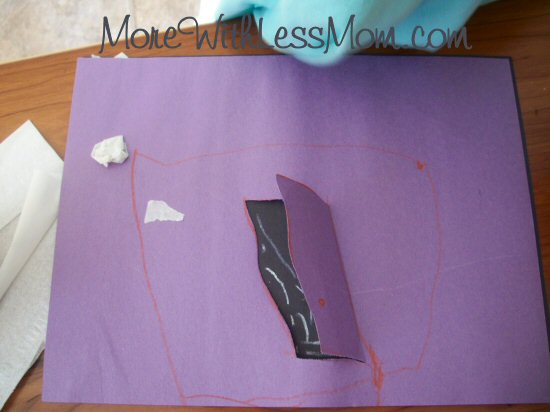 Three year old's abstract haunted house with creative placement of tape